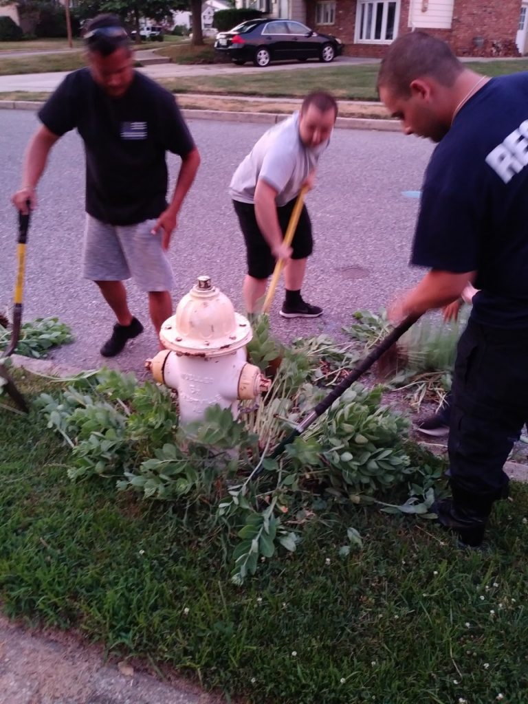 Clearing out fire hydrants even in the summer